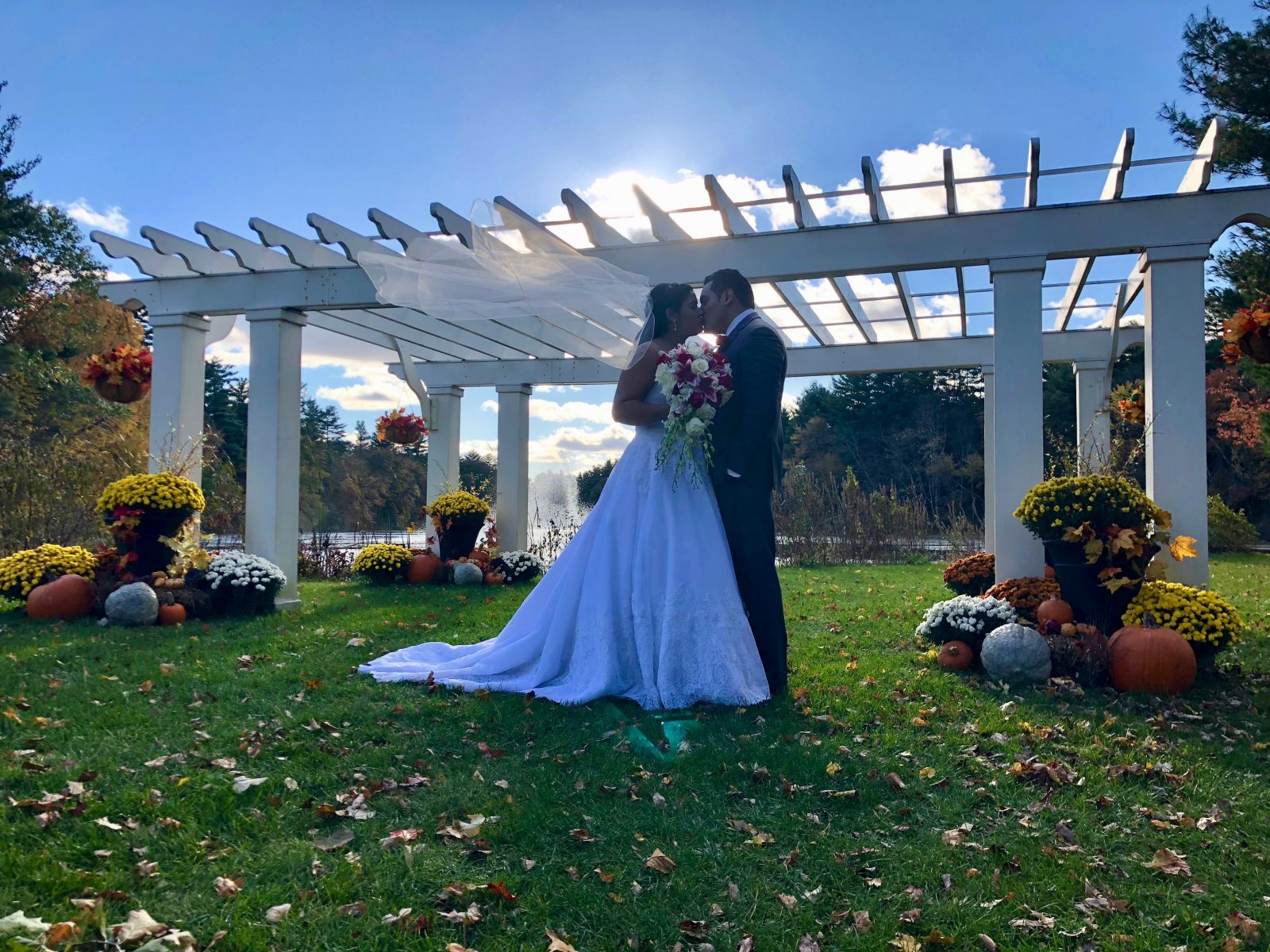 A bride and groom embrace on their wedding day at Butternut Farm Golf Club in Stow, Massachusetts